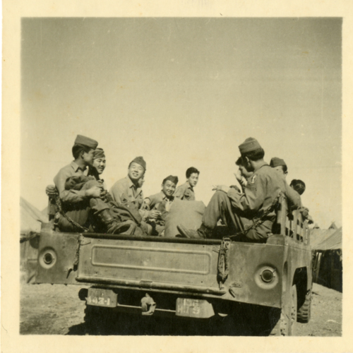 Group of World War Two soldiers sitting in a car