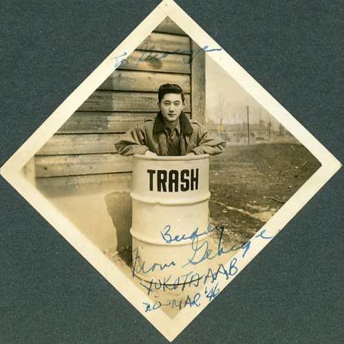 Signed photo of soldier in trash can
