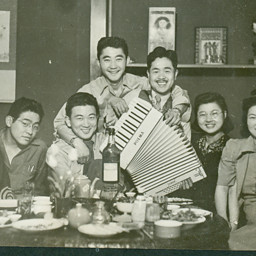 Soldiers and Japanese civilians at a restaurant