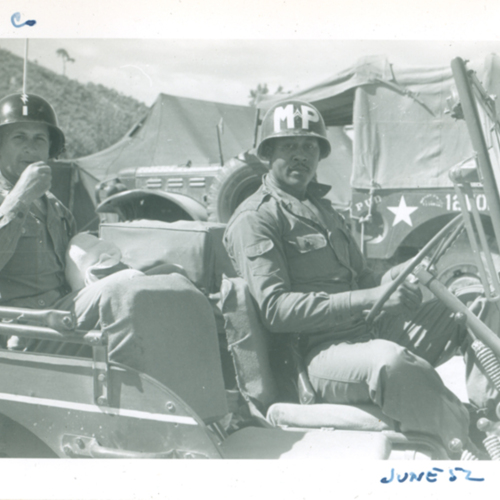 Two soldiers in a jeep
