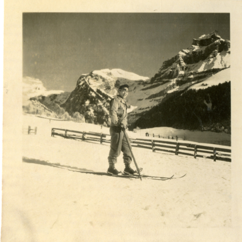 World War Two soldier posing with skis