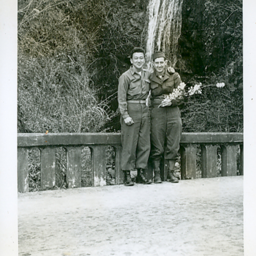 George and another soldier with a cherry blossom branch