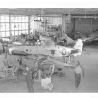 Gilbert T. Tanji album page 68. Aircraft in airfield hangar