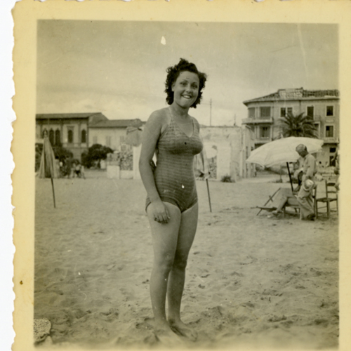 Woman in a bathing suit posing at the beach