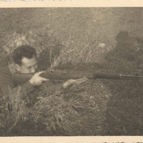 Art Harada with rifle in ditch