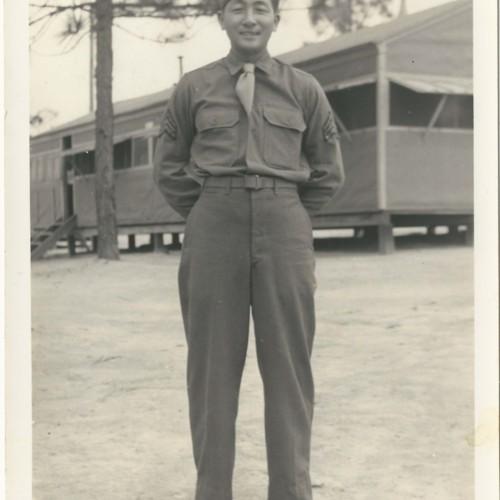 Sadamu Koito in military uniform in front of barracks