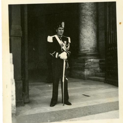 Man in uniform standing in front of a door