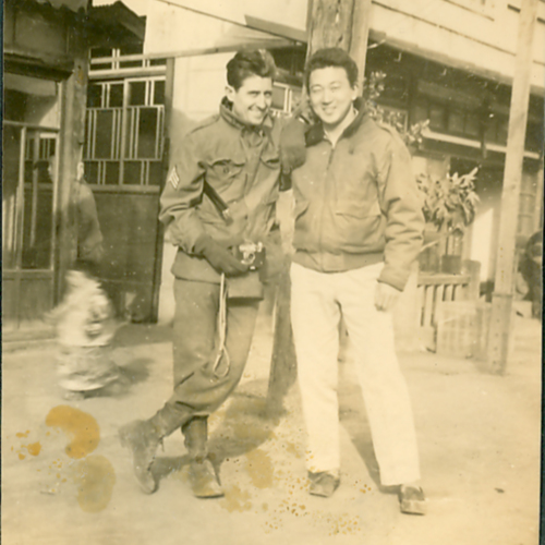 George and another soldier in front of a shop
