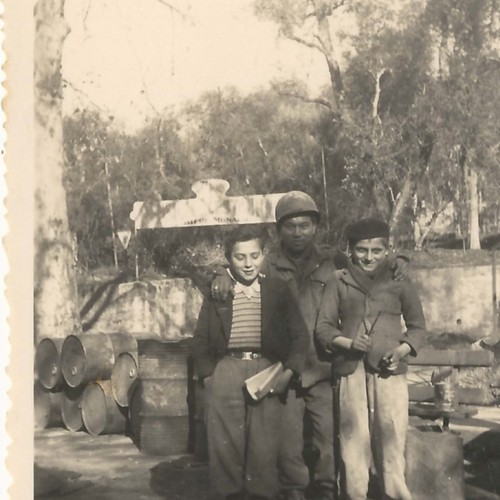 Japanese American soldier with two Italian boys