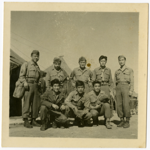 Group of World War Two soldiers posing outside