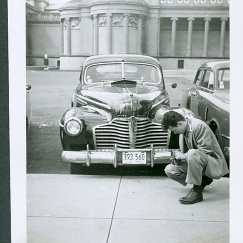 Man in front of a car