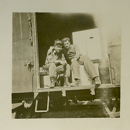 Two soldiers on a train