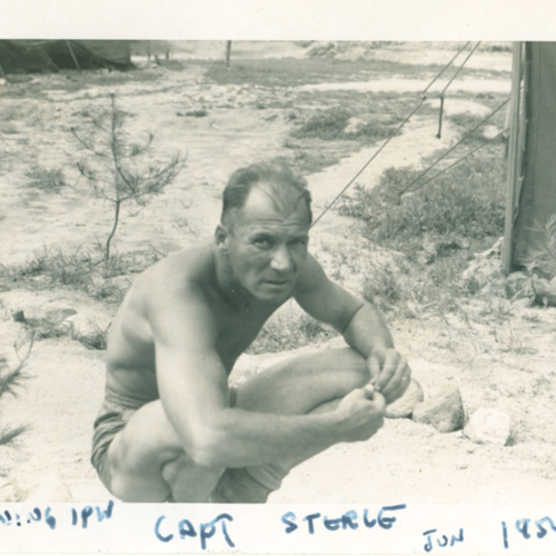 Capt. Sterle squatting in the desert
