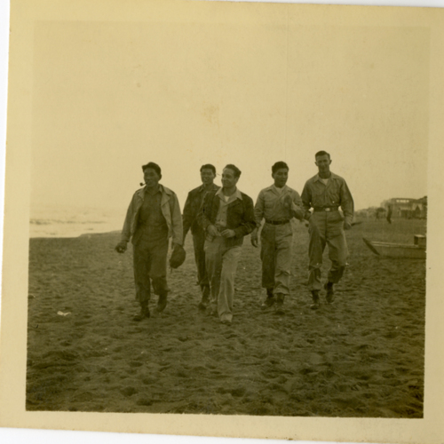 World War Two soldiers walking on a beach