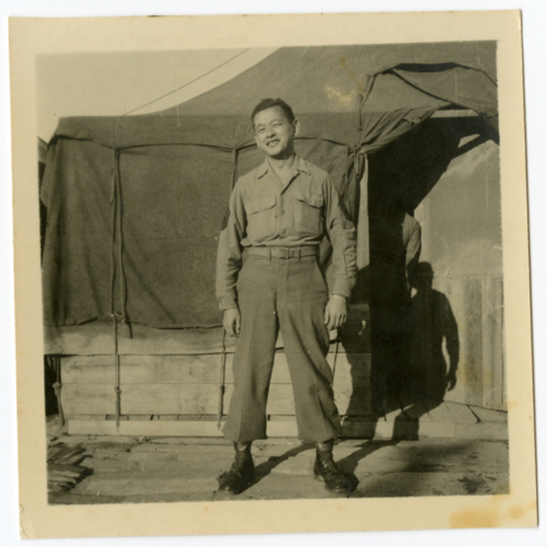 World War Two soldier posing outside of a tent