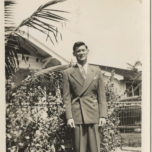 Japanese American man wearing double-breasted suit