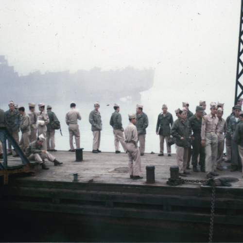 Soldiers standing on a dock