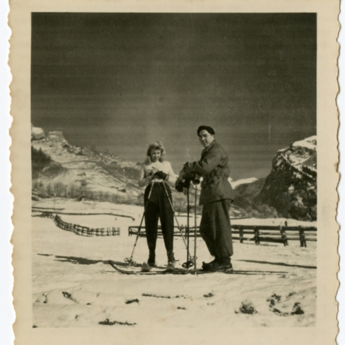 Paul William Nishimuta and a woman posing with skis