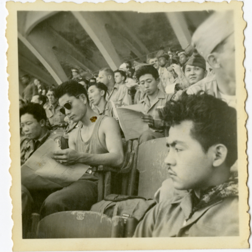 World War Two soldiers sitting in a stadium