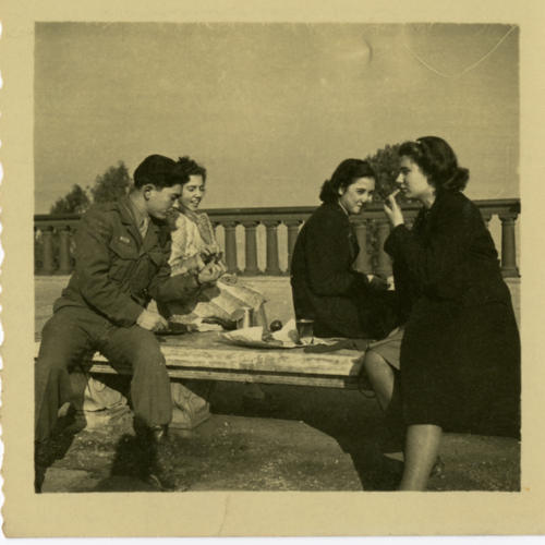 World War Two soldier and women eating outside