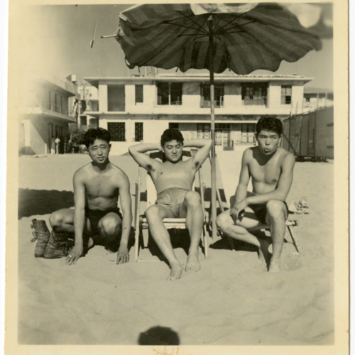 Men posing at the beach