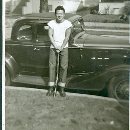 George in front of a car