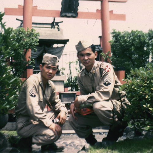 Two soldiers in front of shrine