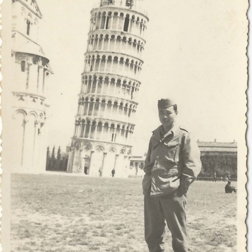 Japanese American soldier in front of Tower of Pisa