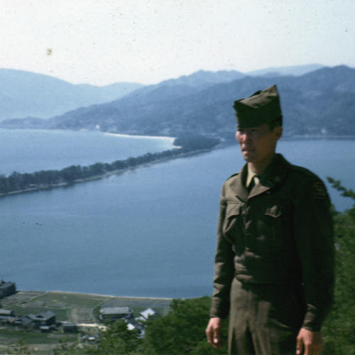 Walter Oka in front of a lake