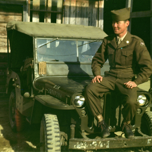 Walter sitting on a jeep