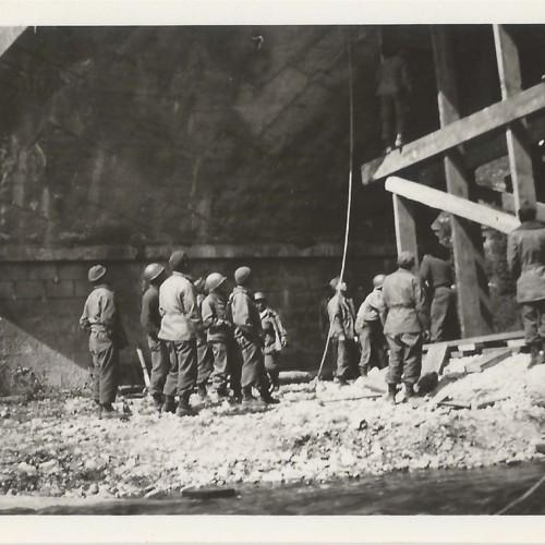 Soldiers under archway with construction scaffolding