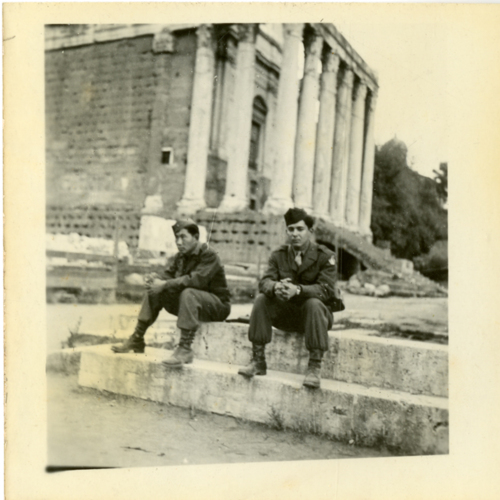 Paul William Nishimuta and a World War Two soldier sitting in front of a building