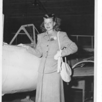 Gilbert T. Tanji album page 64. Caucasian woman in front of airplane