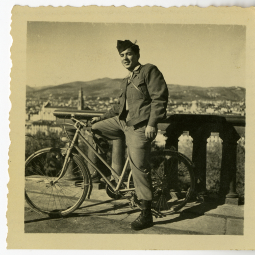 Paul William Nishimuta posing with a bicycle at Piazzale Michelangelo in Florence, Italy
