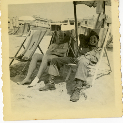 World War Two soldiers sitting on beach chairs