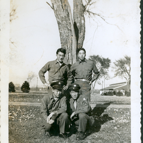 Four soldiers in front of a tree